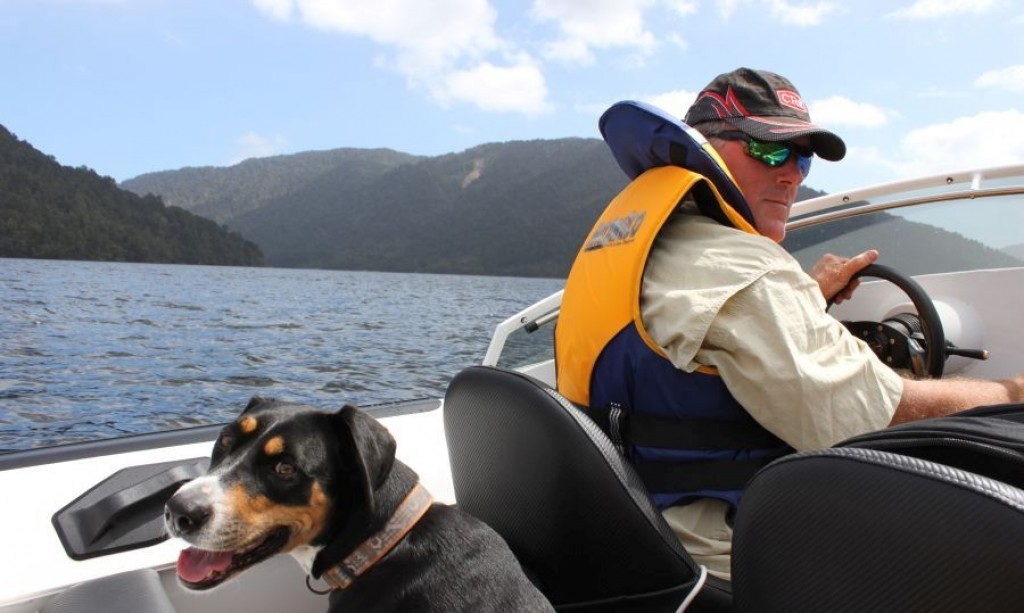 Grant and Roux jetboating on the West Coast